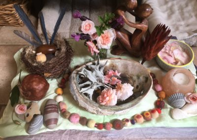 Co-created altar for a mama's final ceremony marking the end of her maternity leave.